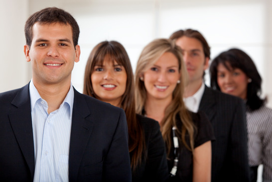 Group of business people in an office lined up
